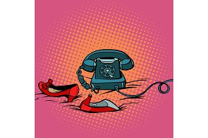 retro phone and womens red shoes