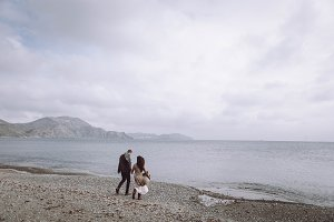 stylish couple, cold sea