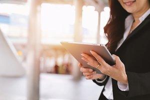 Senior businesswoman using tablet