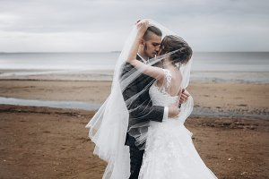 Gorgeous wedding couple by the sea