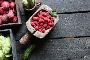 Healthy eating or food, dieting and vegetarian concept. Berries and vegetables on the vintage table.
