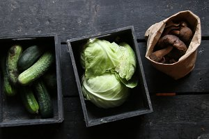 Raw Organic food idea. Green cabbage, Mushrooms and Cucumbers