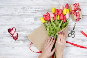 Bouquet of spring tulips and gift