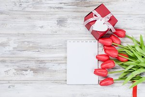 Bouquet spring red tulips and gift