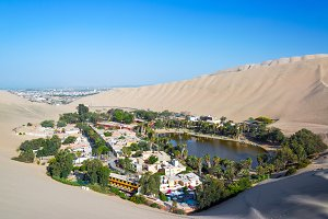 Huacachina with Ica in the Backgroun