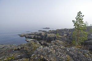 A thick fog over the lake. Karelia.