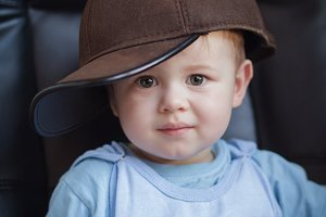 Portrait of a little boy in a cap