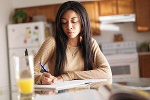 african teen girl doing home work