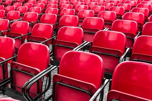 Empty plastic red chairs In outdoor