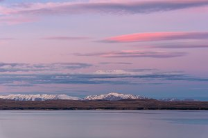 Pink sunset over Southern Alps and Lake Tekapo, New Zealand