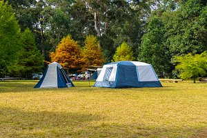Autumn landscape with tourist camping tents