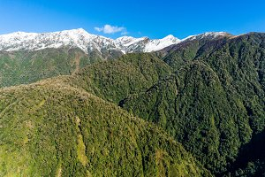 Aerial view of New Zealand mountains, wilderness landscape
