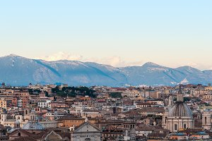 Aerial view of Rome downtown with mountains on the background