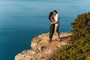 Loving couple hugging on the rock