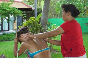 Woman doing massage to girl in asia. Bali,Indonesia.