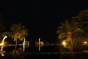Hotel with a pool in the background of the starry sky.