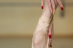 Leg and arms of ballerina. Pointe