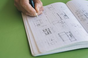 Architect works drawing sketches