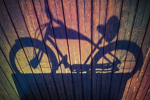 bike shadows silhouette on wooden floor