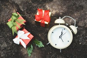 Gift box with white alarm clock