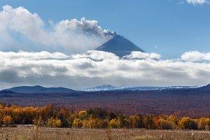 Volcano eruption on sunny autumn day