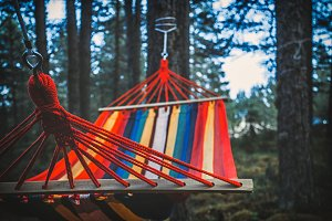 Colorful hammock hanging in the forest. Selective focus