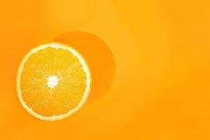 One orange on orange background. Art food concept
