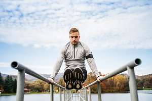 Young man doing exercise in park.