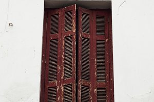 Vintage red shutter window