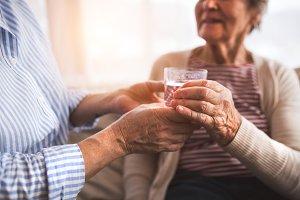 Unrecognizable senior women at home.