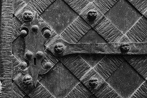 Fragment of the old iron door.