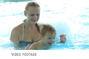 Mother and her son in swimming pool