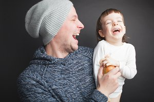 Dad plays with a lovely little son,