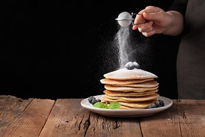 Stack of pancakes with sugar powder