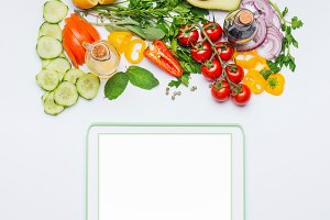 Fresh vegetables and tablet mock up
