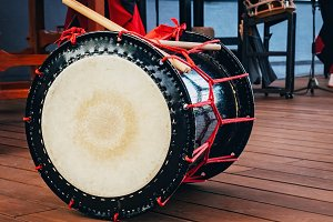 Taiko drums o-kedo on scene background. Culture of Asia Korea, Japan, China