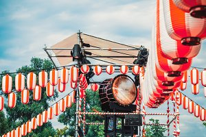 Japanese drum Taiko on the stage of the Yaguro. Paper red-white lanterns Chochin Scenery for the holiday Obon