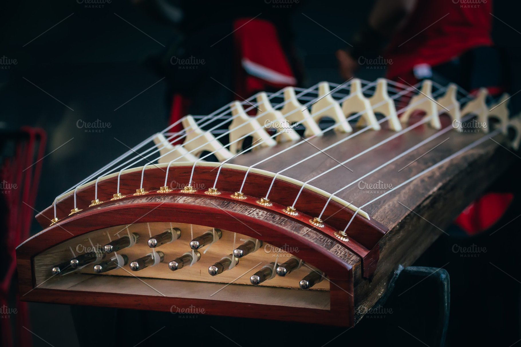 Musical String Instrument of easr asia koto yatga guzheng chinese zither,  zheng, gayageum om dark background  Selective focus on picture