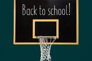 Basketball hoop on blackboard with text Back to school