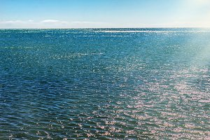 Sea water with sun rays at day