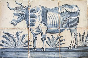 Delft blue tiles with image of cow