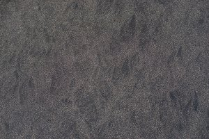 close up of black rough Sandpaper sheet texture use as Background