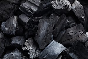 Coal mineral black as a cube stone b