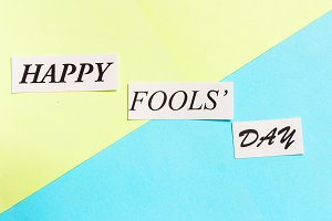Happy Fools Day printed phrase on green blue background