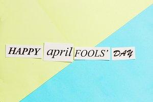 Happy April Fools Day printed phrase on green blue background