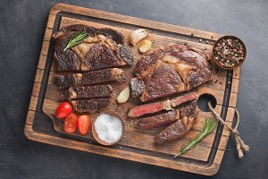 Grilled ribeye beef steak, herbs and