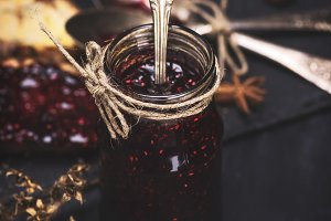 raspberry jam in a glass jar