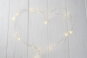 Glowing Christmas tree garland in the form of a heart
