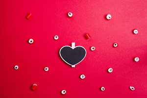 Pattern of heart candies and heart chalk board