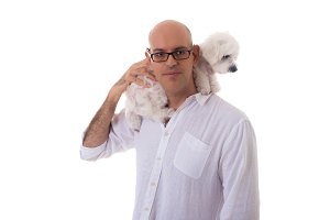 man holding the dog on neck